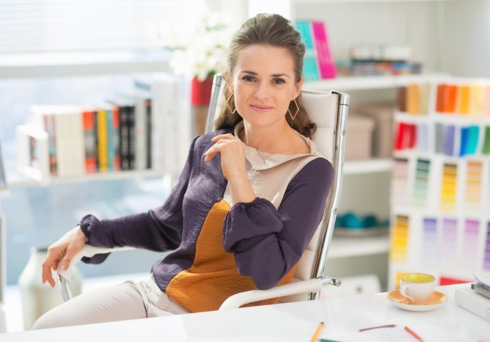 Portrait of fashion designer in office