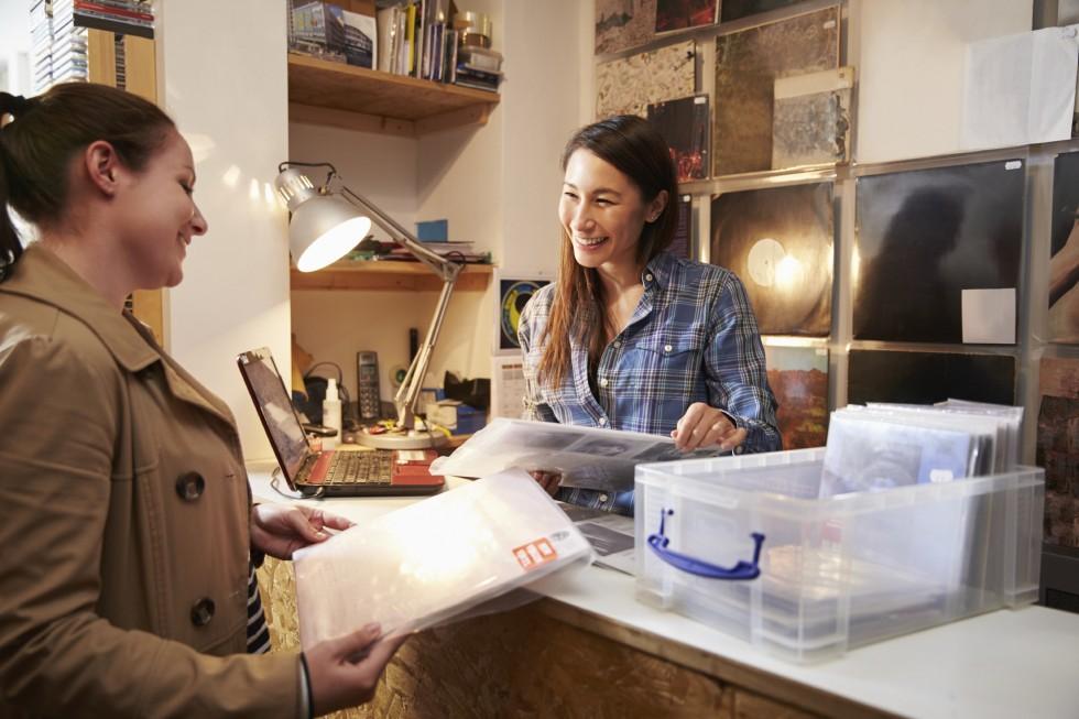 customer-shopping-at-local-record-shop-e1448470238891